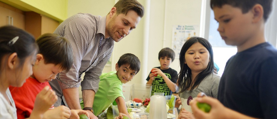 Chefs teach kids in schools how to cook as part of Luminato.