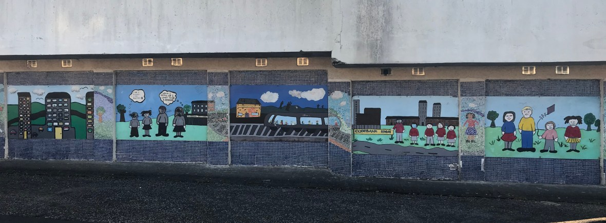 Community mural on a playground wall at Clydebank High School