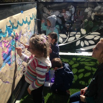 We utilize both of our front and rear garden spaces as outdoor classrooms for building, painting, creating and exploring! The front garden has a treetop vantage point with numerous leaf-shaped openings for greeting neighbors and observing what's happening down on the street.