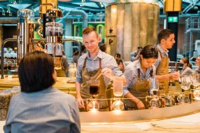 Starbucks barista Gabriel Sebastian Denes works at the siphon brewing station at the Starbucks Reserve Roastery in Milan, Italy on Sunday, August 02, 2018. (Joshua Trujillo, Starbucks)
