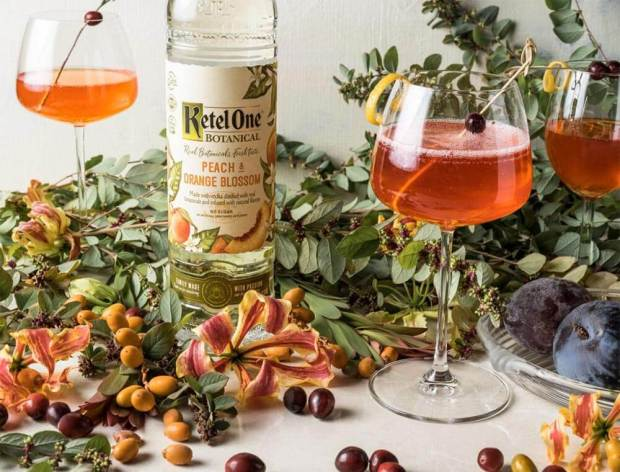 Peaches & Cranberry Spritz, cocktails and ketel one bottle, decorations
