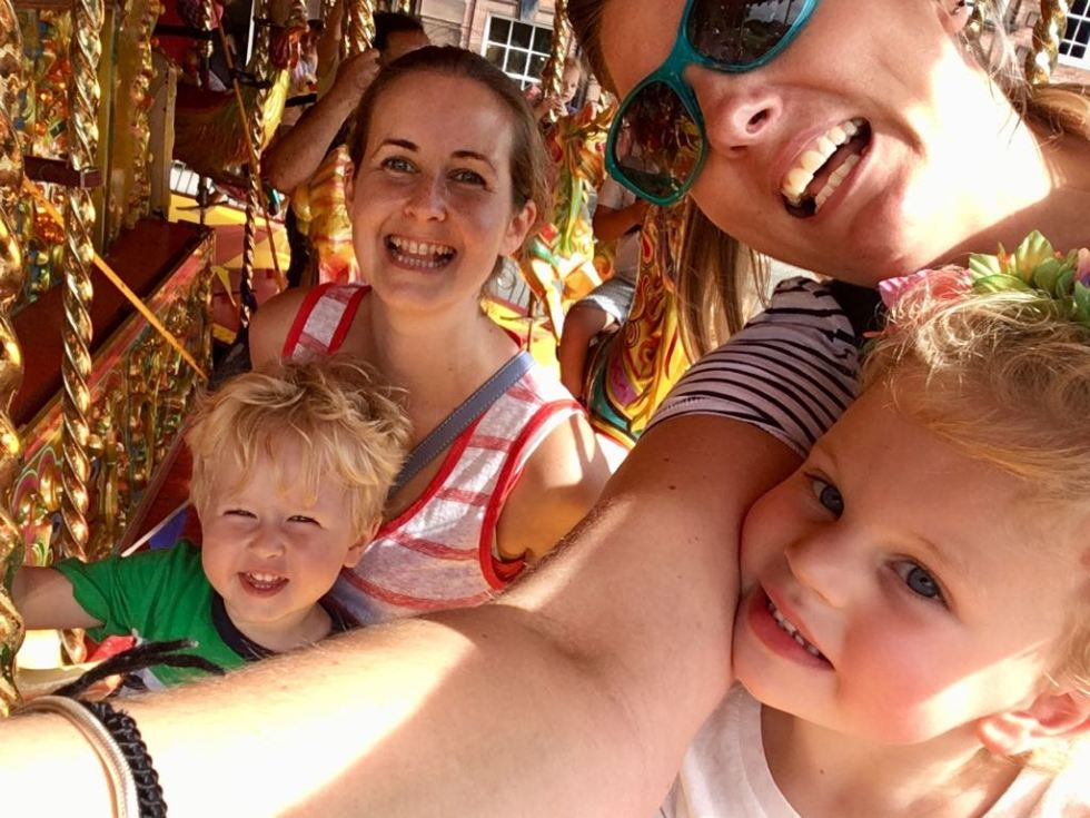 CBBC Summer Social review All 4 of us on the merry go round taking a selfie close up smiling
