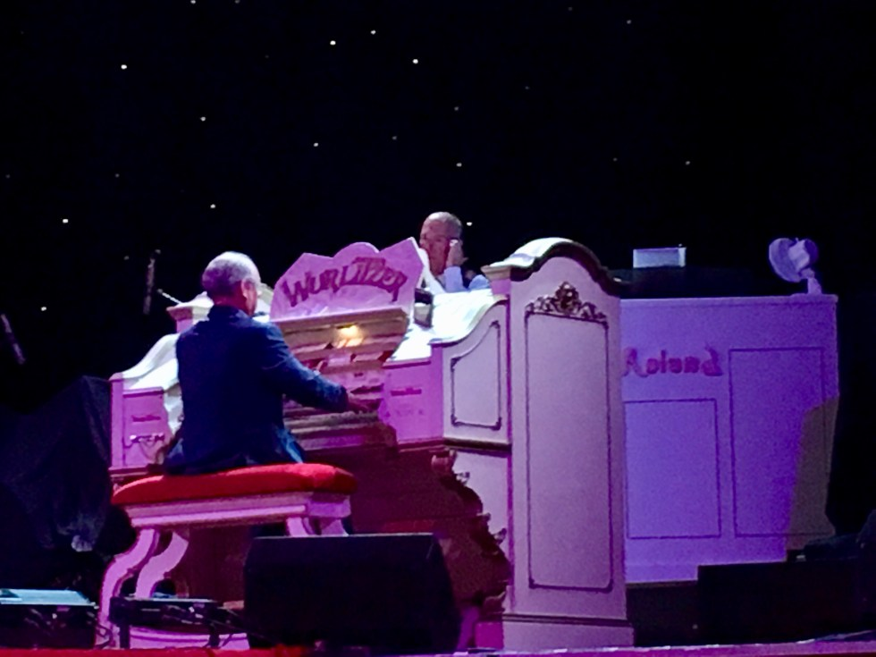 Blackpool Tower. The white Wurlitzer piano with a man playing it, he has his back to the camera