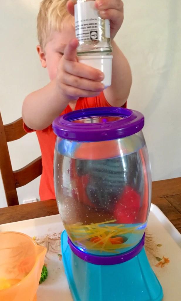 Little Tikes STEM Jr review Lucas putting salt into the tornado canister