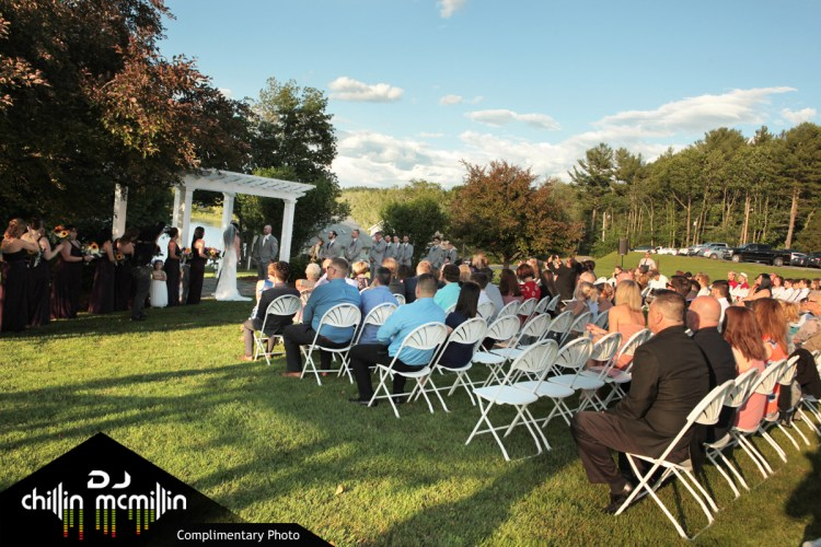Bride and groom at ceremony alter outside