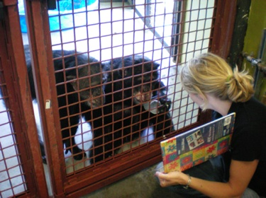 Jamie and Burrito looking at photo album