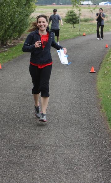 Laura running to the finish