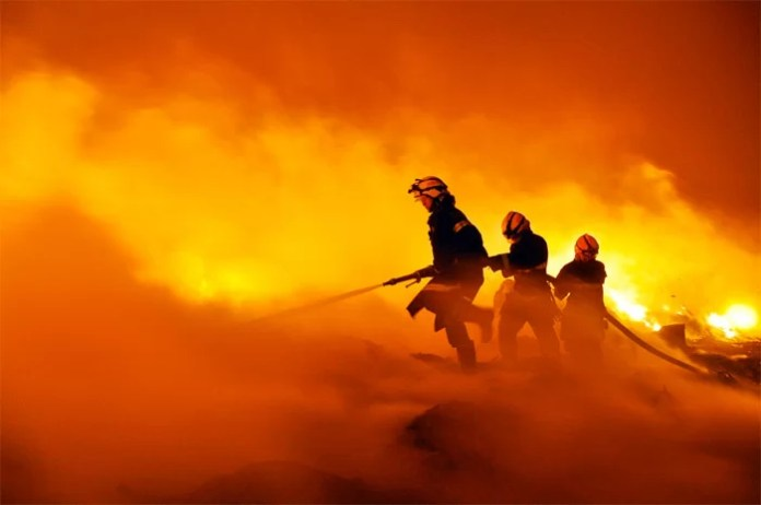 Firefighters fighting flames
