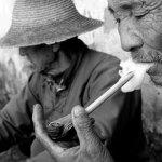 Old Chinese man smocking