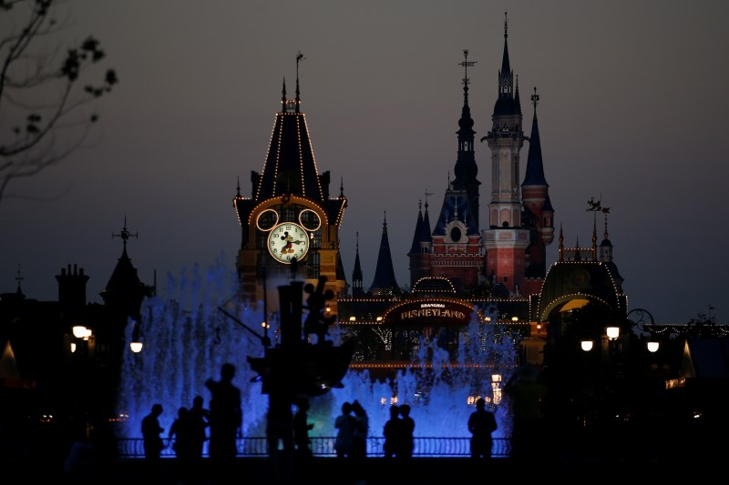 People walk at Shanghai Disney Resort during a three-day Grand Opening event in Shanghai