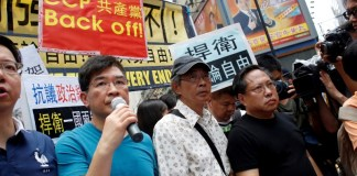 Bookseller Lam Wing-kee takes part in a protest march with pro-democracy lawmakers and supporters in Hong Kong