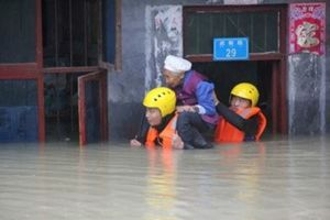 Rescuers save a resident from a flooded building in Chongqing, China. Flooding, an annual problem in China, has been exacerbated by urban sprawl and poor drainage infrastructure in many cities. REUTERS/Stringer