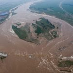 An aerial view shows that roads and fields are flooded in Xingtai