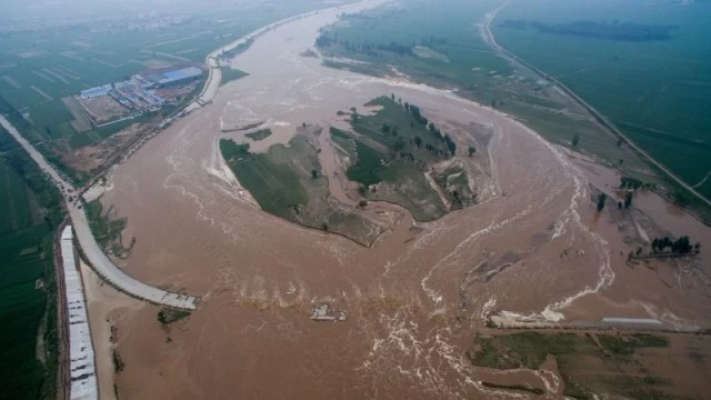 An aerial view shows that roads and fields are flooded in Xingtai, Hebei Province, China, July 21, 2016. REUTERS/Stringer