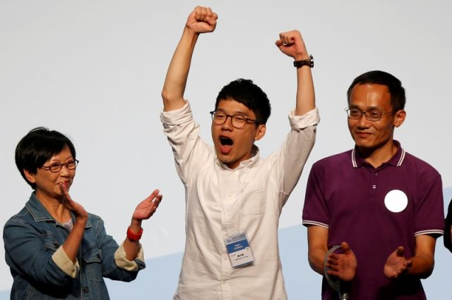 Student leader Nathan Law (C) celebrates on the podium after his win in the Legislative Council election in Hong Kong, China September 5, 2016. REUTERS/Bobby Yip