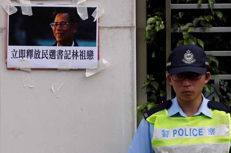 A portrait of the jailed Wukan village chief Lin Zuluan is displayed by protesters outside China Liaison Office in Hong Kong