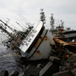A partially capsized fishing ship is seen after Typhoon Meranti made landfall, in Kaohsiung, Taiwan September 15, 2016. REUTERS/Tyrone Siu