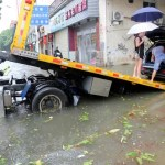 People prepare to move a car onto a trailer after Typhoon Meranti made landfall on southeastern China, in Quanzhou