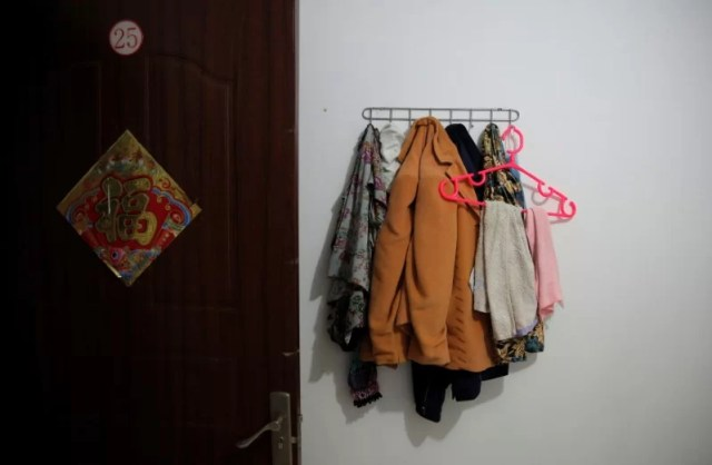 Clothes hang in a room where Huang and her husband Pan stay at the accommodation where some patients and their family members stay while seeking medical treatments in Beijing, China, June 22, 2016. REUTERS/Kim Kyung-Hoon