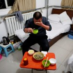 Yuan Yunping wipes sweat from his face as he eats dinner, which his son cooked for him, in his room at the accommodation where some patients and their family members stay while seeking medical treatment in Beijing, China, January 13, 2016. REUTERS/Kim Kyung-Hoon