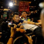 A demonstrator is detained by police during a protest in Hong Kong