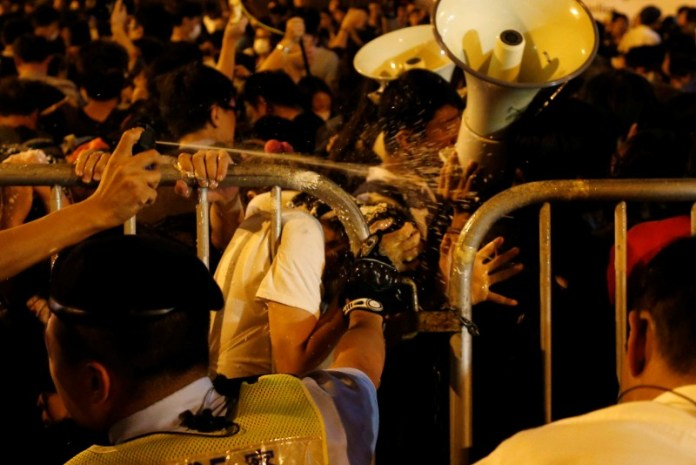 Demonstrators are pepper sprayed by police during a protest against what they call Beijing's interference over local politics and the rule of law in Hong Kong, China, November 6, 2016. REUTERS/Tyrone Siu