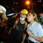 Pro-independence legislator-elect Yau Wai-ching talks with a protester outside China Liaison Office in Hong Kong