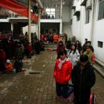 People attend Sunday service at a makeshift, tin-roofed church in Youtong village