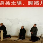 Men attend Sunday service at a makeshift, tin-roofed church in Youtong village