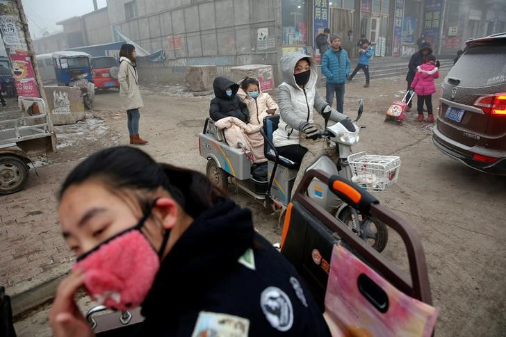 Trucks are stranded near a highway during a polluted day in Shijiazhuang
