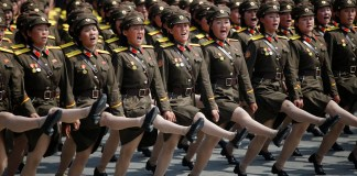 North Korean soldiers march and shout slogans during a military parade marking the 105th birth anniversary of country's founding father in Pyongyang