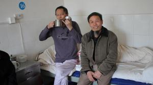 Zhu Chengzhi (right) with Li Wangyang in Li's hospital room just days before Li was found dead.