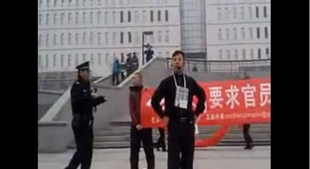 Four activists in Xidan, Beijing, on March 31.