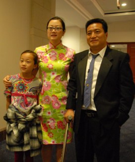 Fang Zheng, wife, and their oldest daughter in 2009.