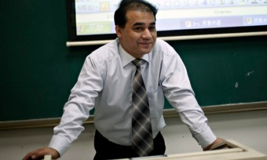 Ilham Tohti, teaching economics at Minzhu University in Beijing.