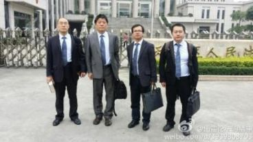 Four defense lawyers in front of the court house.