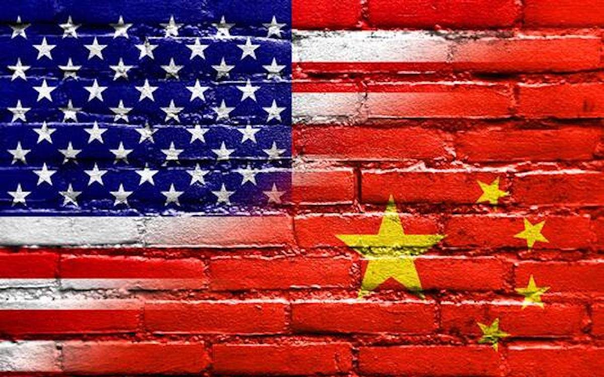 The image shows a brick wall painted in the American and Chinese flags. Relations between Beijing and Washington are seriously strained.