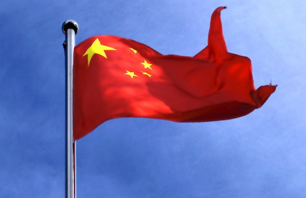 The photo shows a Chinese national flag. Is the sun starting to set on China's global ambitions.