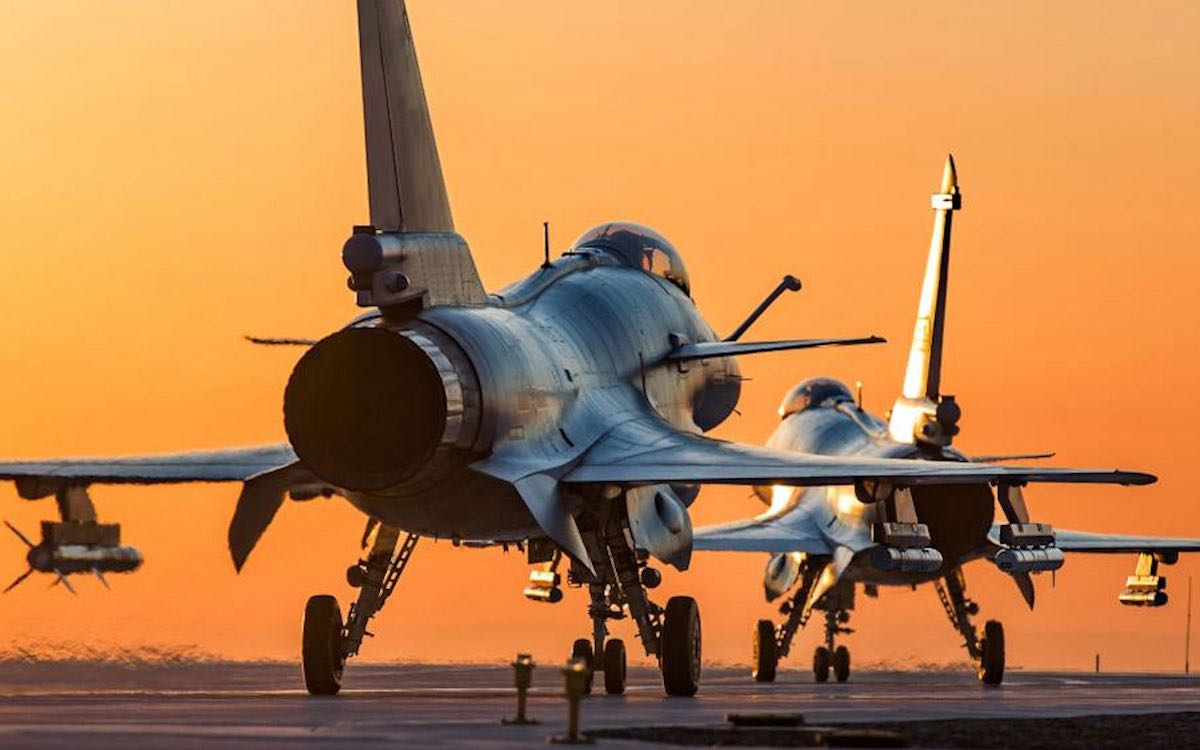 The photo shows two PLA fighter jets taking off as the sun rises over the airfield. Chinese military aircraft have again pierced Taiwan's air defense corridor on Friday.