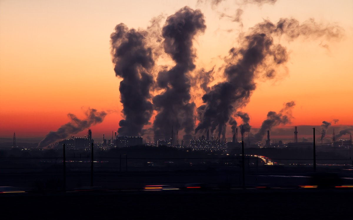 Smoke bellows into a red sky at night from a power complex. Coal is still king in China.