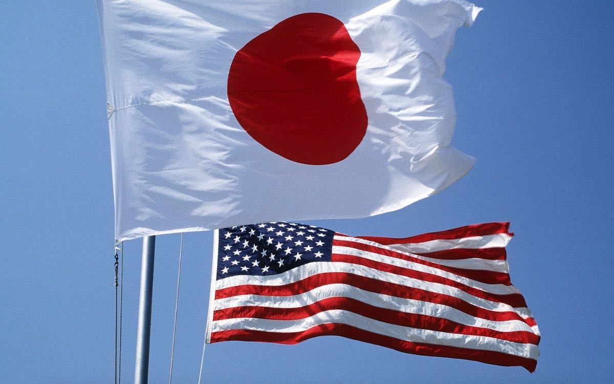 The photo shows the Japanese and American flags. Washington has gone on a concerted campaign to rebuild alliances after the Trump era.