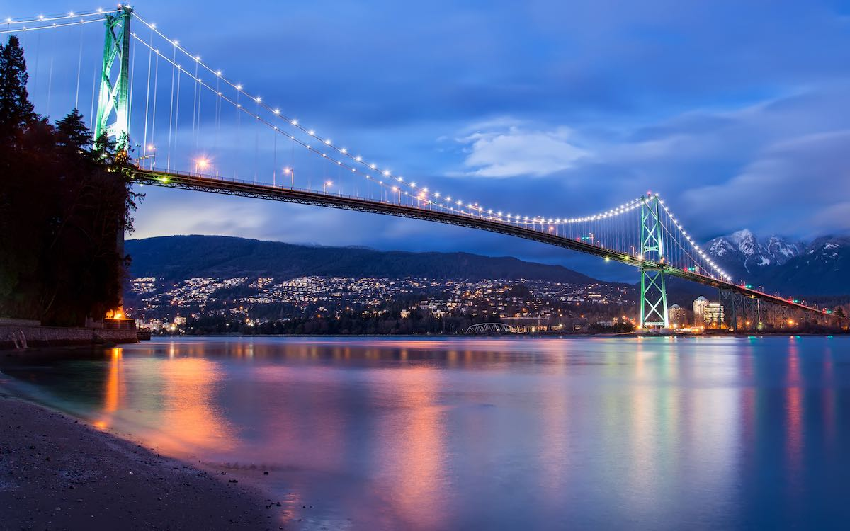 The photo shows the Lions Gate Bridge in Vancouver decked out in lights. Property prices in the metro area of the Canadian city continue to rise.