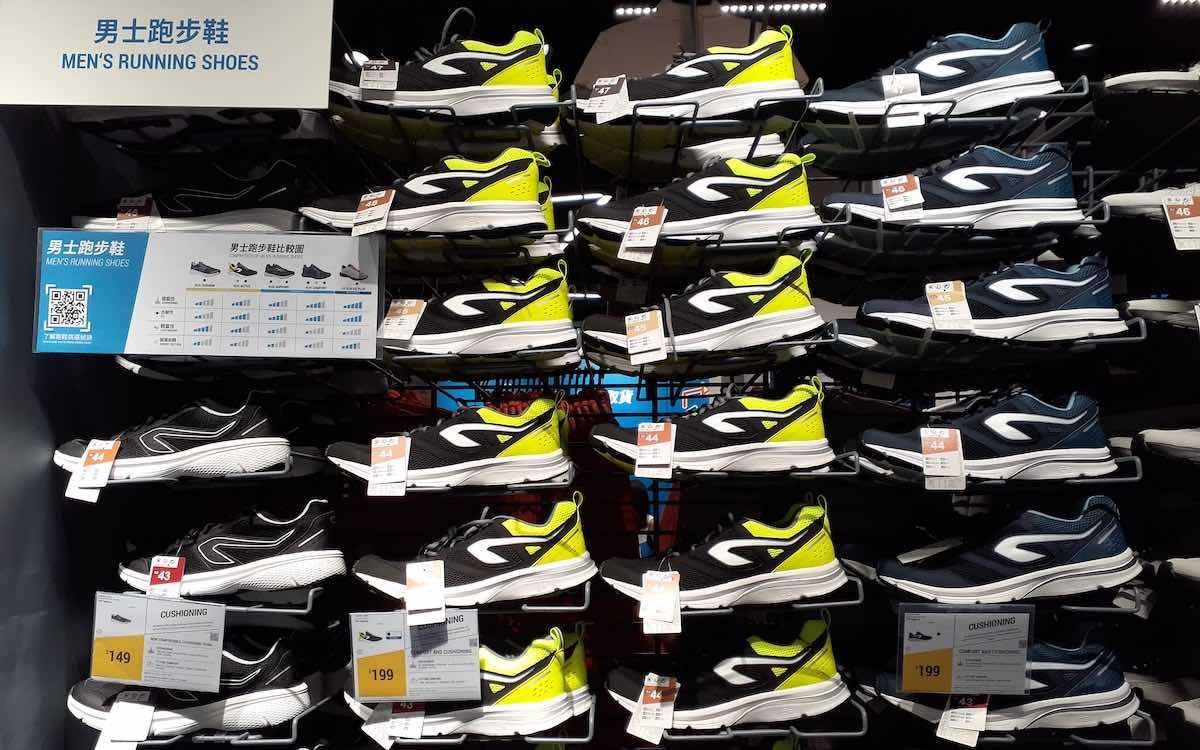 The photo shows Nike sports shoes stacked up in a rack in a Chinese store. The sports wear giant has run into a political storm.