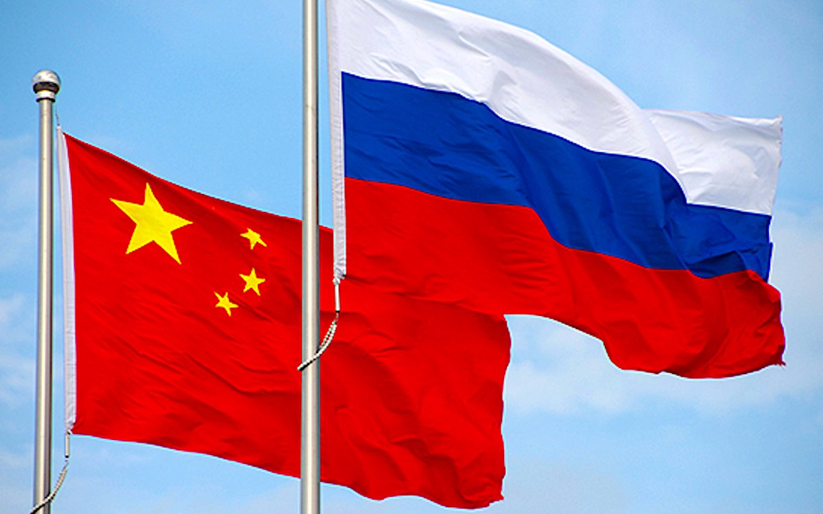 The photo shows the flags of China and Russia fluttering in the wind. Beijing and Moscow have laid down the gauntlet to the United States.