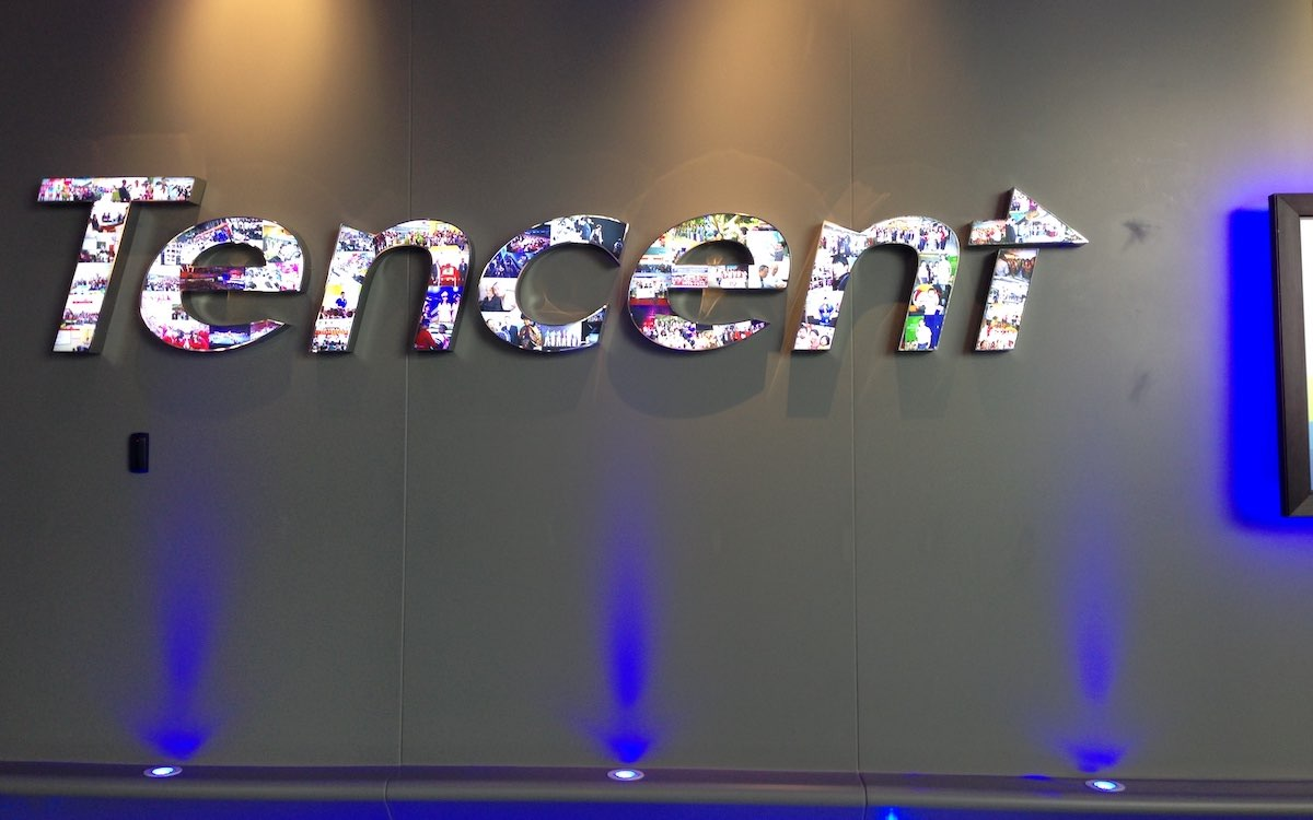 The image shows the Tencent logo decked out in an array of colors. China's regulators have put the spotlight on Tencent.