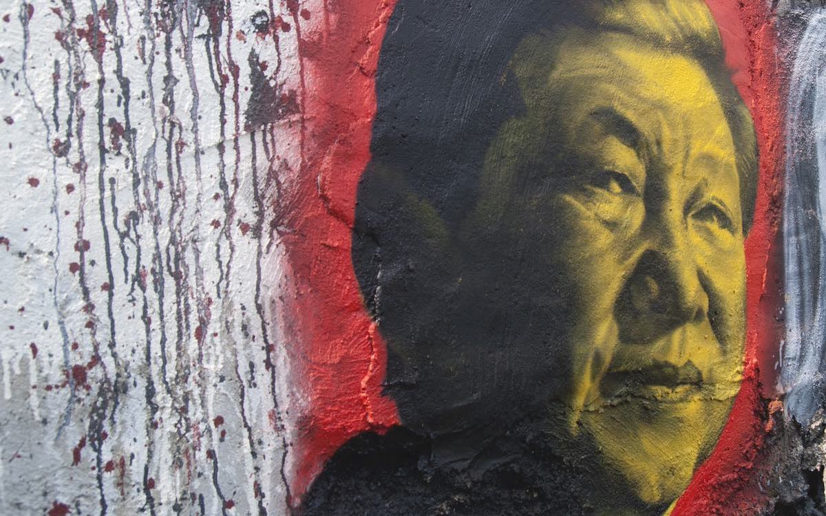 The image shows a mural of China's President Xi Jinping. He has cultivated his image as a 'strong man' politician.