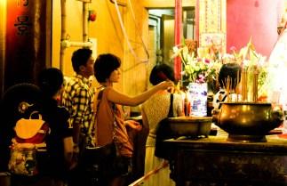 Visitors burn incense in Man Mo Temple