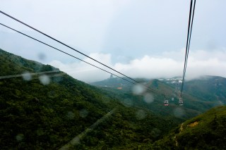 The Big Buddha that overlooks the monastery complex becomes visible through the clouds.
