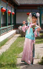 A chinese girl dresses in tradition clothes at grand view park