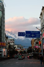 A photo of Lijiang-New town, with Jade Dragon Snow Mountain in the distance.